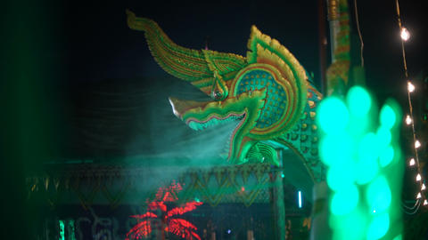 Humidification from the mouth of a dragon at Thai Temple Footage