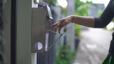Getting electricity bill out of post box closeup Footage