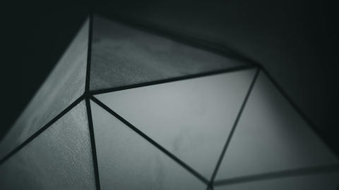 Black polygonal shape with grunge surface loopable 3D render Animation