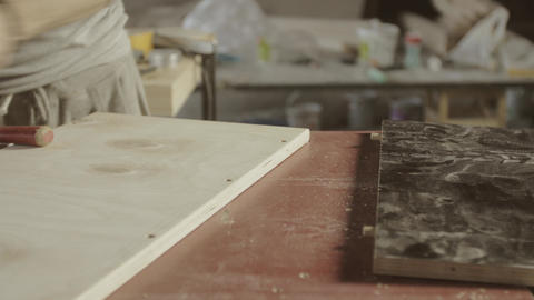 Professional woodworker connects two wooden board. Process of assembly furniture Live Action