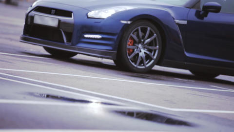 View of dark blue new car. Wheel disks. Presentation. Headlights. Showing. Autom Footage