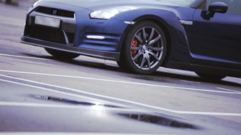 View of dark blue new car. Wheel disks. Presentation. Headlights. Showing. Autom Footage
