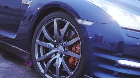 View of wheels iron disk of dark blue new car. Presentation. Headlight. Sun. Aut Footage