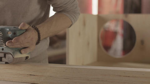 Woodworker process surface of wooden board by belt sander. Smoothing Live Action