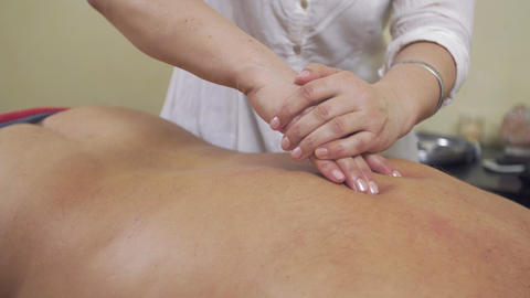 Close up masseuse hands push backbone of fat man by one hand. Remedial massage Footage