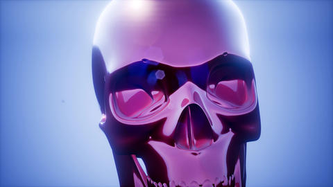 metall skull rotate on colored background 影片素材
