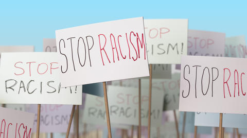 STOP RACISM placards at street demonstration. Conceptual loopable animation Live Action
