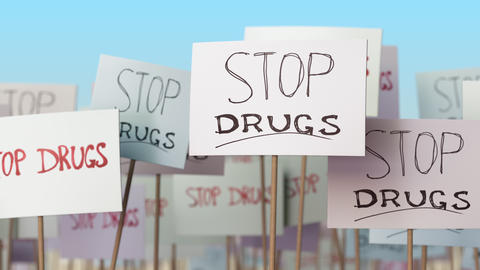STOP DRUGS placards at street demonstration. Conceptual loopable animation Live Action