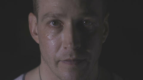 Intense sweaty face of young muscular man pulling rope Footage