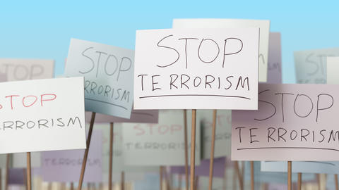 STOP TERRORISM placards at street demonstration. Conceptual loopable animation Live Action
