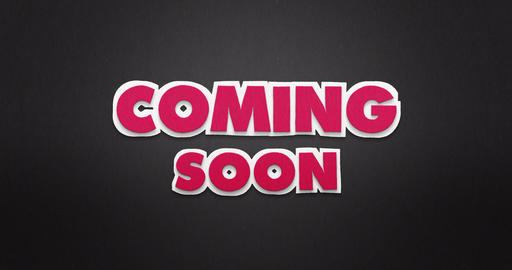 Coming soon in pink on black paper. stop motion animation. 4K Animation