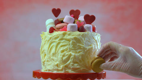4k Decorating cake with macaron cookies, marshmallows and candy for Mothers Day, Footage