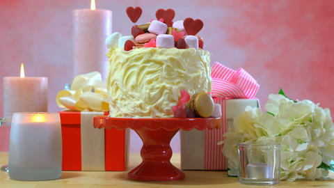 4k Setting table with cake, candles and gifts for Mothers Day, Valentine or Footage