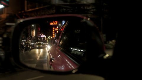 View of traffic at Chinatown/Yaowarat, Thailand from car side mirror Footage