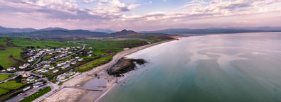 The Skyline of Criccieth and beach after sunset, Wales, UK Photo