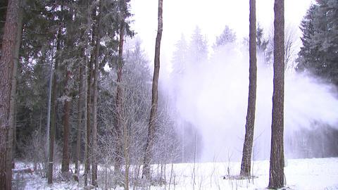 Snow cannon pours snow on ski slope Live Action