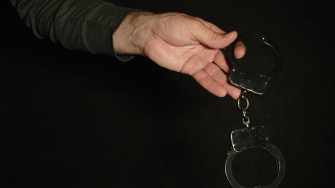 Handcuffs are thrown by hand Footage