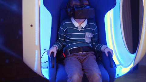 Excited boy enjoying virtual reality attraction Footage