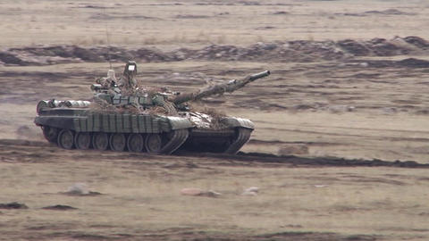 Russian tank rides in the desert Live Action