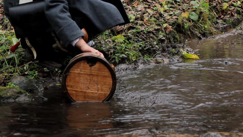 In 1812, French soldiers wash bucket in the stream Live Action