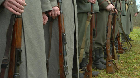 German soldiers stand in formation with rifles Live Action