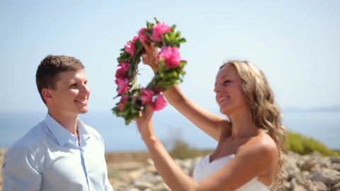 Happy newlyweds at the beach Live Action