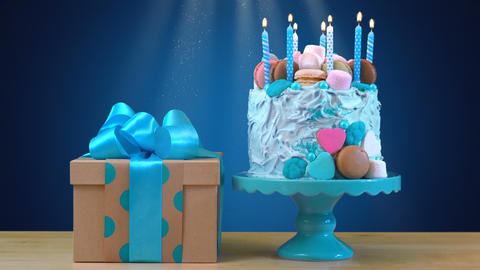 Blue birthday celebration showstopper cake decorated with candy, marshmallows Footage