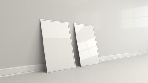 Blank white poster in white frame standing on the floor Photo