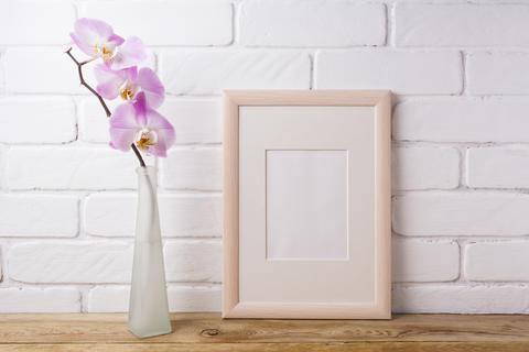 Wooden frame mockup with tender pink orchid Photo