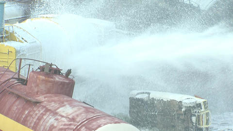 the fire and disaster on the railway, extinguish a fire hose filled with foam Footage