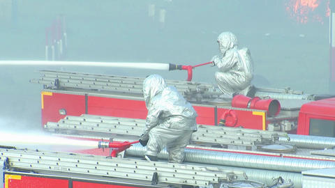 The fire brigade puts out the fire hoses Footage
