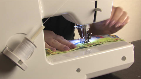 Sewing lowers the needle and works on the sewing machine Live Action
