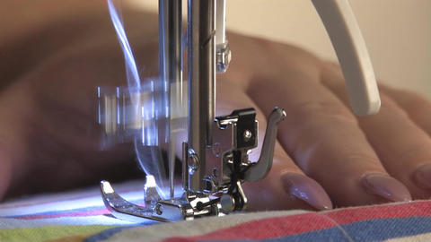 Work on the sewing machine, the seamstress sews the stitching Live Action