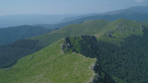 Fly over top of the mountain green grass landscape in high altitude mountain Bul Footage