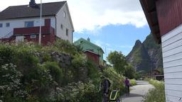 Norway Moskenesoy island village Å i Lofoten bicyclists on idyllic footpath Footage