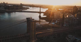 Aerial, The sun's rays illuminate the bridges of New York, the sunset Footage