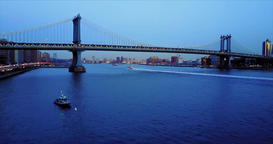 Aerial, flight under the bridge against the backdrop of New York evening Footage