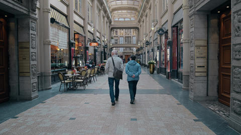 LEIPZIG, GERMANY - MAY 1, 2018. Senior couple walking in the Madler Passage Footage