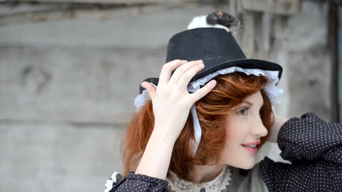 Beautiful red-haired girl posing with hand-made rat Live Action