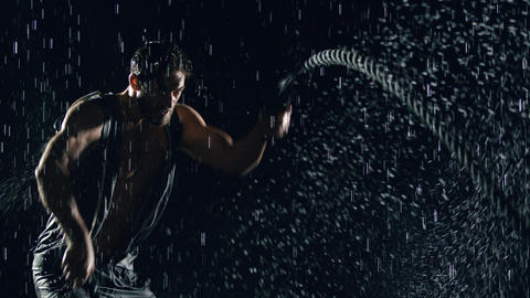 Athletic Man Working Out In The Rain GIF