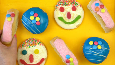Pop Art Color style donuts and bakery goodies on bright colorful background Footage