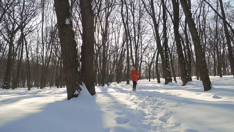 Adorable boy run in winter park in slow motion Footage