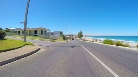 Vehicle POV, driving along The Esplanade, Moana, South Australia overlooking Footage