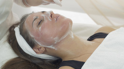 Close up cosmetologist hands, face wipe off mask out girl face in beauty saloon Live Action
