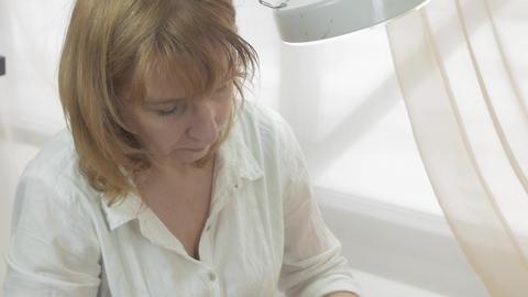 Cosmetologist smear bit moisten cream on woman face in beauty saloon. Skincare Live Action