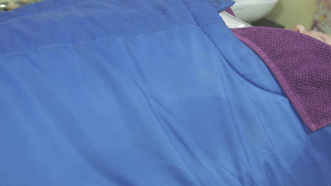 Fat adult woman lie in professional saloon, covered by thermal blanket. Spa wrap Footage