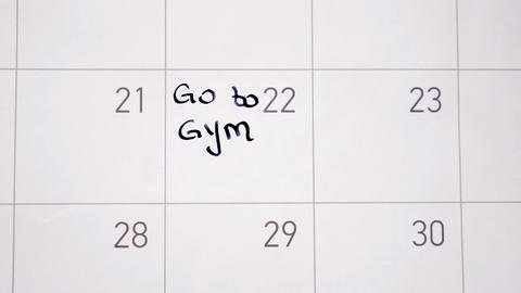 Animation writing go to gym marking the day in calendar with black ink Animation