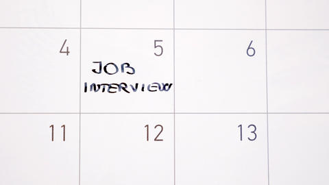 Animation writing job interview marking the day in calendar with black ink Animation