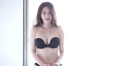 Portrait Of Sensual Asian Woman Smiling On Bed At Home Footage