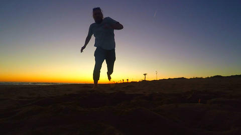 Man Running In The Beach GIF